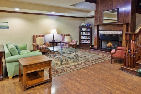 Lobby with fireplace, couches and bookshelves