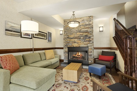 Spacious lobby with fireplace and seating in Smyrna