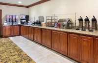 Breakfast bar with coffee, cereal and juice dispensers