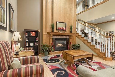 Hotel lobby with fireplace, books and staircase