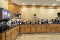 Wooden cabinets and breakfast spread in hotel dining area