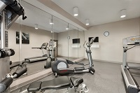 Fitness center at Warner Robins, GA hotel with treadmill and more