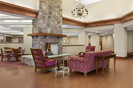 Hotel lobby with stone fireplace in center of room