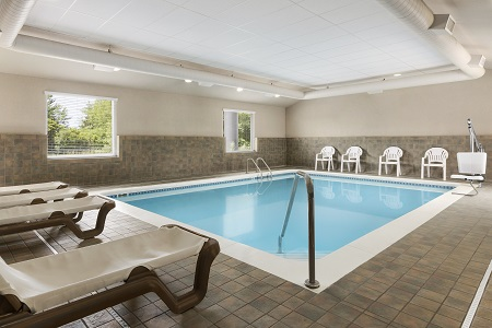 Indoor pool and chaise lounges at the Country Inn & Suites in Holland, MI