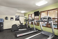 Ames hotel's fitness center with treadmills