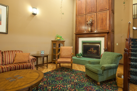 Lobby with a fireplace, coffee table and chairs