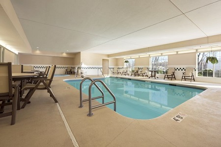 Heated indoor pool with patio area in Clinton hotel
