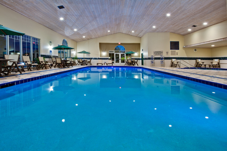 Indoor pool with chairs and tables