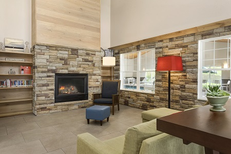 Inviting lobby with fireplace and lending library