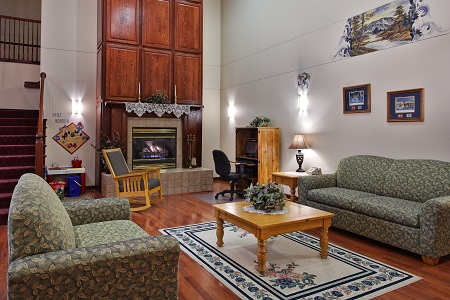 Welcoming hotel lobby with sofas and fireplace