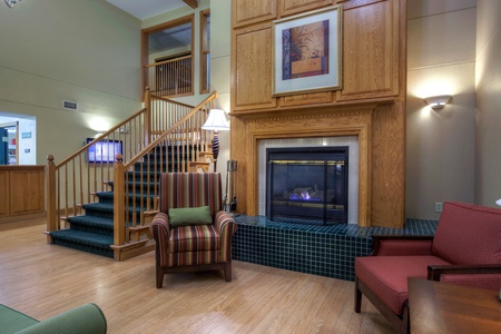 Hotel's lobby fireplace with seating