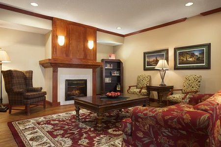 Hotel lobby with fireplace, coffee table and chairs