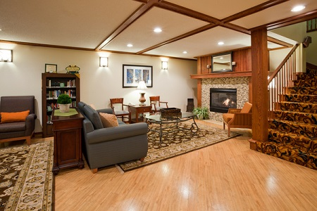 Spacious lobby with fireplace and seating in Pella