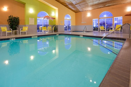 Indoor pool and lounge chairs in Pella