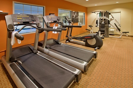Treadmills, bike and weight machine in fitness center