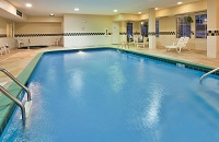 Heated indoor pool and lounge chairs in Bloomington