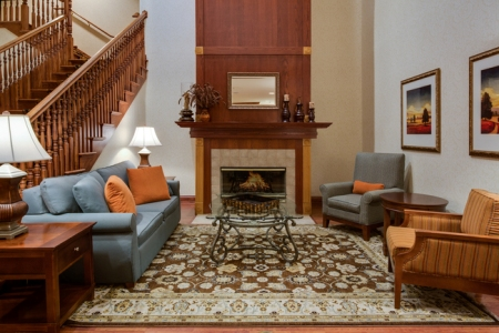 Comfortable hotel lobby with patterned rug and seating area