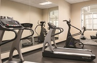 Fitness center with two treadmills and other cardio equipment