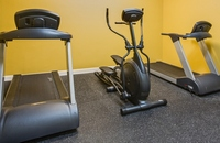 Fitness center with two treadmills and elliptical