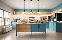 Breakfast room with coffee, pastries, a waffle station and blue cabinets