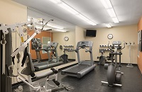 Fitness center with a multi-gym, a treadmill, an elliptical and a recumbent bike