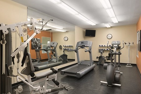 Fitness center at Moline airport hotel with treadmill and more