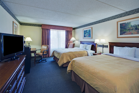 Hotel room in Naperville with two beds, a work desk and a flat-screen TV