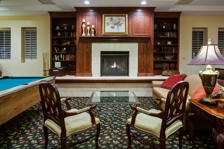Naperville hotel's inviting lobby with a fireplace and a pool table