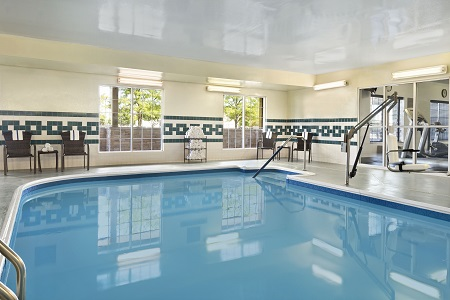 Romeoville hotel's indoor pool with view of fitness center