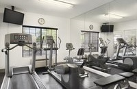 Hotel fitness center with elliptical and treadmill