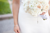 Bride holding a white bouquet