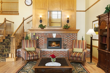 Lobby with fireplace and armchairs