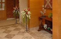 Lobby area with flowers and flower pots