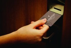 Guest unlocking the door with a key card
