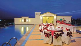 Enjoy Poolside Dining at the Country Inn & Suites Hotel in Amritsar