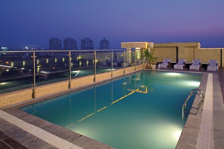 Rectangular Rooftop Swimming Pool Overlooking Gurugram