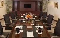 Comfortable work chairs surround out hotel's conference table