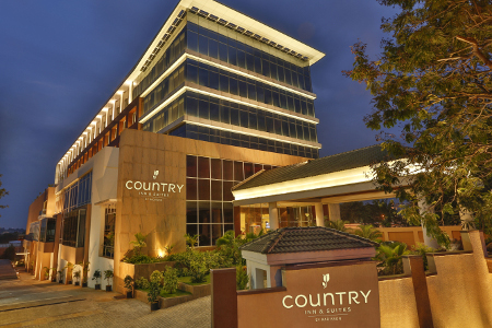 Modern exterior of the Country Inn & Suites in Mysore