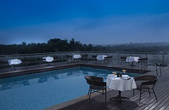 Poolside dining at the Country Inn & Suites in Mysuru
