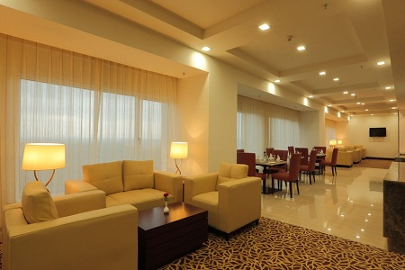 Hotel lounge with plush seating and dining tables