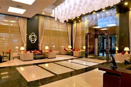 Hotel lobby with modern lighting and marble floors