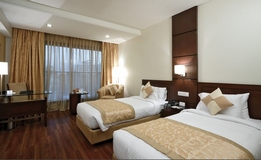 Indore hotel guest room with two beds