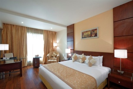 Modern accommodation in Indore with king bed, desk and armchair