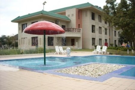 Outdoor pool with a red umbrella fountain
