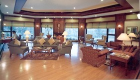 Vaishno hotel's tea lounge with comfortable sofas and chairs