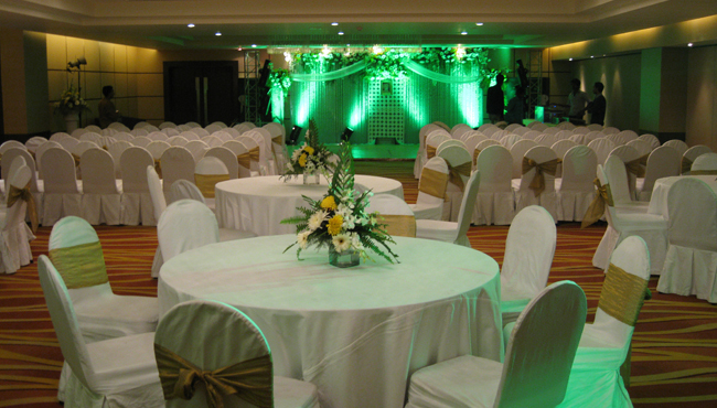 Wedding setup with green lighting on the stage area