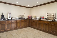 Breakfast area with assortment of hot and cold foods