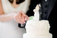 Wedding couple cuts a white cake