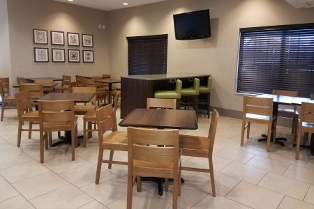 Breakfast dining area with table seating and a TV