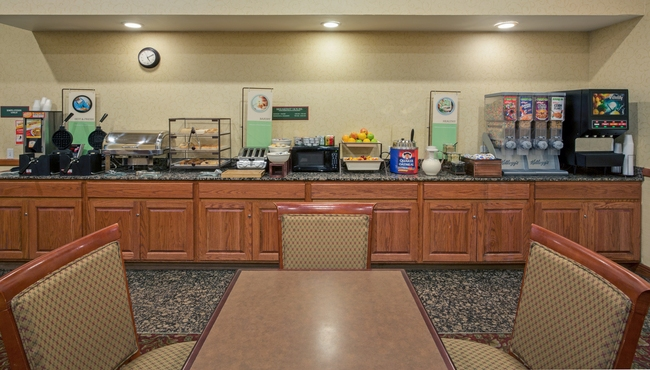 Dining area with cereal, fresh fruit and pastries